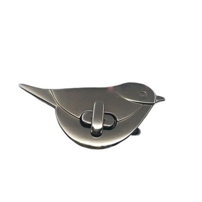 картинка замок для сумки поворотный птица , цвет: никель